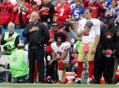 Colin Kaepernick takes a knee